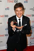 NEW YORK-APR 29: Dr. Mehmet Oz holds a photo of granddaugher Filomena at the Time 100 Gala for Most