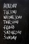 stock photo of weekdays  - Conceptual weekdays list written on black chalkboard blackboard - JPG