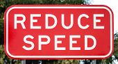 Australian Road Sign: REDUCE SPEED