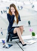 Stressed Junior Executive Dynamic Working Outside Of Her Office