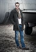 Man with Scarf standing by a Plane
