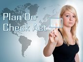 stock photo of plan-do-check-act  - Young woman press digital Plan Do Check Act button on interface in front of her - JPG