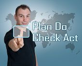 image of plan-do-check-act  - Young man press digital Plan Do Check Act button on interface in front of him - JPG