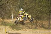 Quad Racer In Yellow Is Jumping