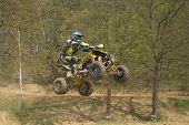 Dynamic Shot Of Quad Racer Jumping