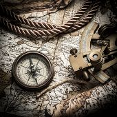 vintage still life with compass,sextant and old map.map used for background is in Public domain. Map