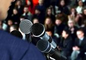foto of seminar  - Image of Man at Seminar Giving Speech - JPG