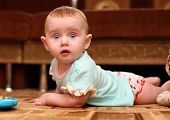 Surprised Baby On The Floor