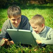 Happy Brothers With Laptop