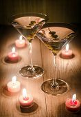 Two Olive Martini Cocktails In The Candlelight