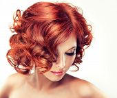 Beautiful model with red curly hair
