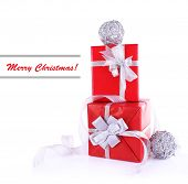 Red holiday gift boxes decorated with ribbon isolated on white