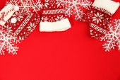 Christmas decorations on red fabric background