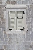 Window Closed White Shutters, Montenegro. Close-up