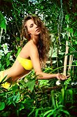 Beautiful sexual young woman in bikini in the rainforest. Vacation. Tropics.