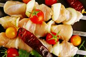 fresh raw chicken kebabs served with vegetables