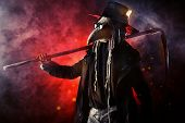 image of scythe  - Portrait of a terrible plague doctor with a scythe - JPG