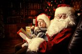 picture of christmas-eve  - Santa Claus in his everyday clothes in Christmas home decoration - JPG