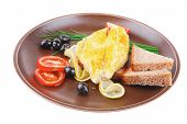 grilled fish fillet served with tomatoes,olives and bread
