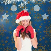 Festive blonde with boxing gloves against blue vignette