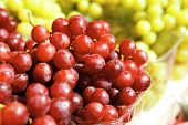 fresh raw lot of red and green grapes on counter