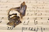 Gramophone on old sheet music - retro art background