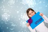 Cute little girl showing card against digitally generated delicate snowflake design