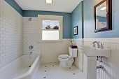 stock photo of tub  - Bathroom interior with blue wall and white plank panel trim - JPG