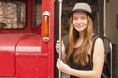 Attractive young hipster girl on the background of an old truck.