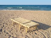 Bamboo chaise longue on beach