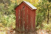 image of outhouses  - Found this on one of my road trips through Missouri - JPG