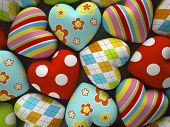 Patterned fabric hearts on dark background 3d