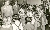 LODZ, POLAND, CIRCA FIFTIES: Vintage photo of women with children during Christmas party in kindergarten