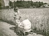 POLAND, CIRCA FIFTIES: Vintage photo of mother and daughter in pram
