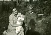 LODZ, POLAND, AUGUST 9, 1953: Vintage photo of mother with sons