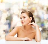 beauty, health and people concept - smiling beautiful woman with clean perfect skin over lights background