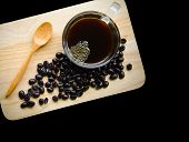 Black Coffee In Glass Cup And Seed Coffee