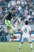 CARSON, CA - OCT 19: Lamar Neagle & Dan Gargan (back) in action during the Los Angeles Galaxy MLS game against the Seattle Sounders on October 19th 2014 at the StubHub Center.