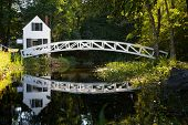 White wooden bridge reflected in a pond, Somesville, Mount Desert Island, Maine, USA