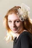 Redhead In Cream Fascinator And Black Top