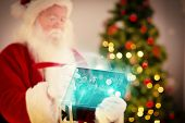 Composite image of santa checking his list