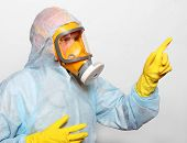 image of respiration  - Man in protective clothing with respirator - JPG