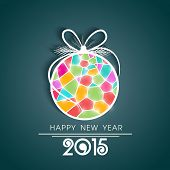 Colorful christmas ball on green background for Happy New Year 2015 celebrations.