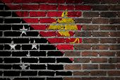 pic of papua new guinea  - Very old dark red brick wall texture with flag  - JPG