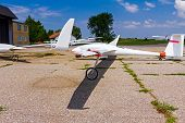 stock photo of glider  - Sailplane glider airplane wide angle shot on the airfield waiting for take - JPG