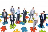 Group of Business People with Jigsaw Puzzle
