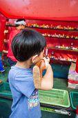 Boy using air gun