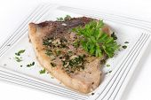 picture of swordfish  - Swordfish steak cooked on a plate with a parsley and garlic butter sauce - JPG