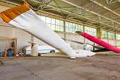 Lightweight Gliders Stationed Inside Of A Big Hangar