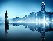 Silhouette of Business Person in Urban Scene